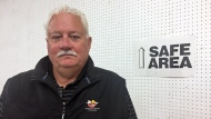 Robert Freberg, the former president of the Saskatoon Wildlife Federation, poses for a photo at a shooting range. (Angelina Irinici/CTV Saskatoon)