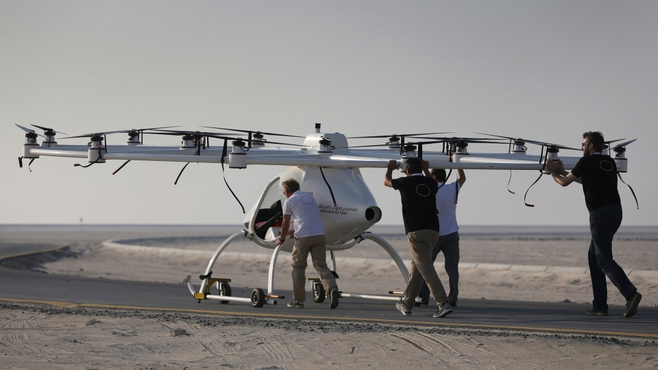 In this Sept. 26, 2017 photo, a Volocopter prototype is being pushed by their operators before it sets for a test fly in Dubai, United Arab Emirates, Tuesday, Sept. 26, 2017. (AP Photo/Kamran Jebreili)