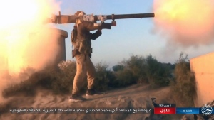 """This image posted online on Thursday, Sept. 28, 2017, by supporters of the Islamic State militant group on an anonymous photo sharing website, purports to show an Islamic State fighter firing his weapon during clashes with Syrian troop in the eastern Syrian province of Deir el-Zour. The Arabic caption reads, """"The incursion of Sheikh Abu Mohammed al-Adnani may God give him mercy. Striking at Nusayris with shells (Nusayri is a derogative term for Alawites)."""" (militant photo via AP)"""