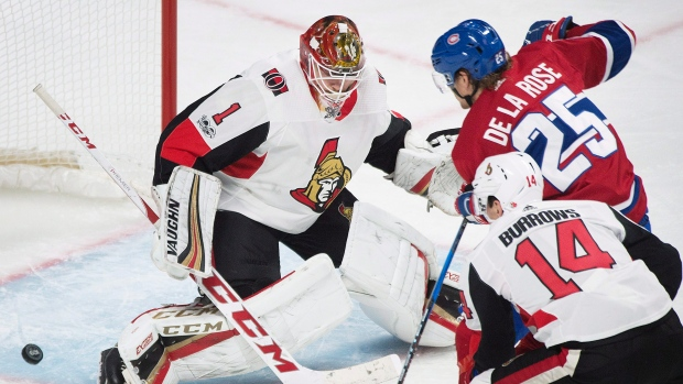 Montreal Canadiens' Jacob De La Rose scores against Ottawa Senators goaltender Mike Condon as Senators' Alexandre Burrows defends during third period NHL pre-season hockey action in Montreal, Saturday, September 30, 2017. THE CANADIAN PRESS/Graham Hughes
