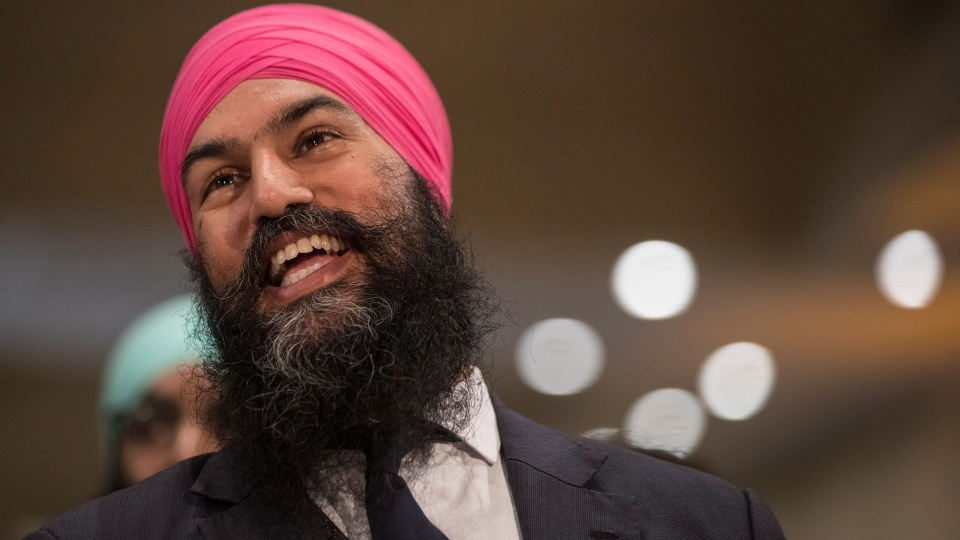 Jagmeet Singh listens a speech before the announcement he won the first ballot in the NDP leadership race to be elected the leader of the federal New Democrats in Toronto on Sunday, October 1, 2017. THE CANADIAN PRESS/Chris Young