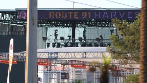 A sign hangs at the Route 91 Harvest Music Festival venue Monday, Oct. 2, 2017, in Las Vegas. (AP Photo/Ronda Churchill)