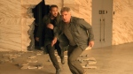 """This image released by Warner Bros. Pictures shows Ryan Gosling, left, and Harrison Ford in a scene from """"Blade Runner 2049."""" (Stephen Vaughan / Warner Bros. Pictures)"""