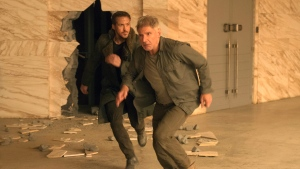 "This image released by Warner Bros. Pictures shows Ryan Gosling, left, and Harrison Ford in a scene from ""Blade Runner 2049."" (Stephen Vaughan / Warner Bros. Pictures)"