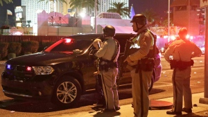 Police stand at the scene of a shooting along the Las Vegas Strip in Las Vegas on Monday, Oct. 2, 2017. (AP / John Locher)