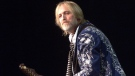 Tom Petty and the Heartbreakers performs at the opening of the SFX Verizon Wireless Amphitheater Saturday, May 19, 2001, in San Antonio, Texas. (AP Photo/San Antonio Express-News, Tom Reel