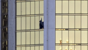 A broken window is seen at the Mandalay Bay resort and casino on the Las Vegas Strip following a deadly shooting at a music festival in Las Vegas in this photo taken on Monday, Oct. 2, 2017. (AP / Chris Carlson)