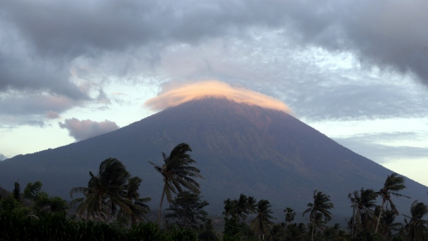 Priests Scale Bali Volcano on the Verge of Erupting