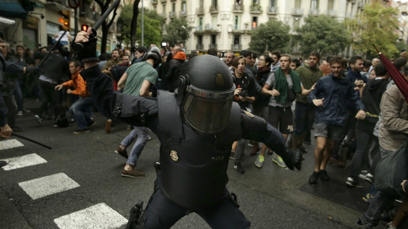 Catalans urged to hold strike to protest crackdown after independence referendum