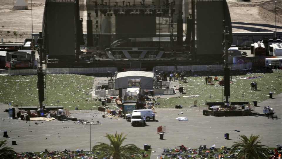 Debris is strewn through the scene of a mass shooting at a music festival near the Mandalay Bay resort and casino on the Las Vegas Strip in Las Vegas on Monday, Oct. 2, 2017. (AP / John Locher)
