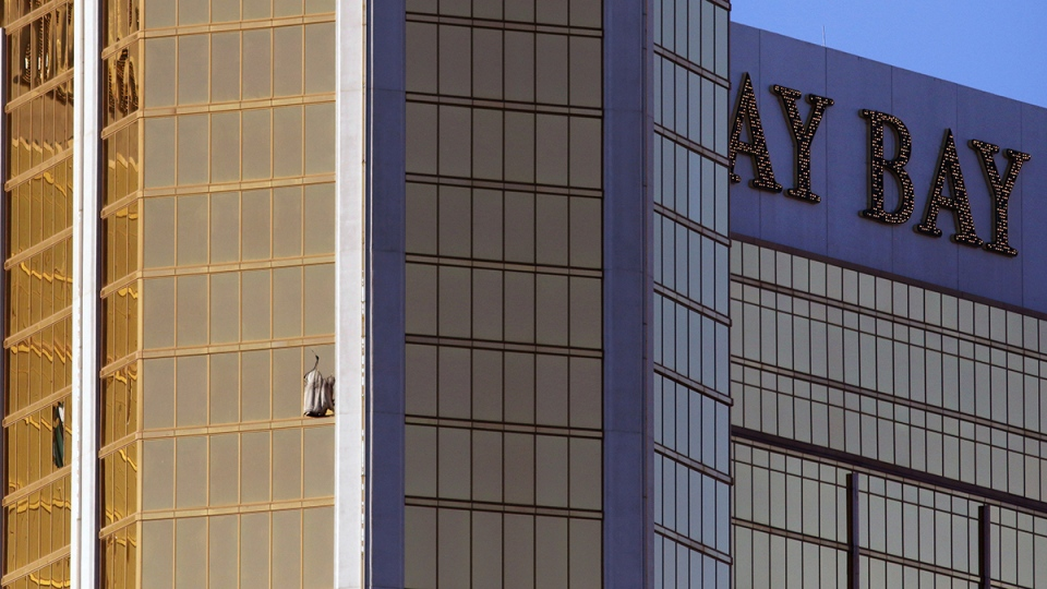 Drapes billow out of a broken window at the Mandalay Bay resort and casino on the Las Vegas Strip following a deadly shooting at a music festival in Las Vegas on Monday, Oct. 2, 2017. (AP / Ronda Churchill)