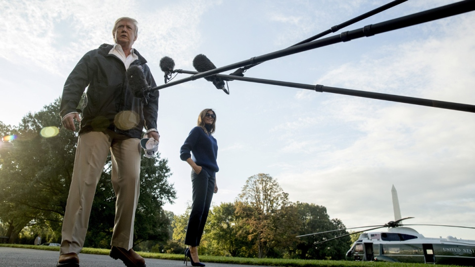 U.S. President Donald Trump, accompanied by first lady Melania Trump, as he walks to board Marine One on the South Lawn of the White House in Washington, on Oct. 3, 2017. (Andrew Harnik / AP)