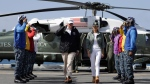 President Donald Trump arrives with first lady Melania Trump to meet with U.S. Virgin Islands Governor Kenneth Mapp, on the USS Kearsarge off the coast of San Juan, Puerto Rico, Tuesday, Oct. 3, 2017. Trump is visiting Puerto Rico in the wake of Hurricane Maria.(AP Photo/Evan Vucci)