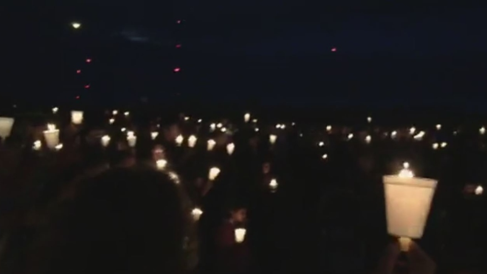 Hundreds lit candles and comforted each other in a church parking lot on Tuesday night to remember Jessica Klymchuk. (Facebook)