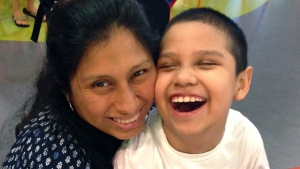 In this undated photo provided by Boston Children's Hospital, Liliana Rojas poses with her son Brandon. Brandon was diagnosed with adrenoleukodystrophy in August 2014. (Courtesy of the Rojas Family/Boston Children's Hospital via AP)