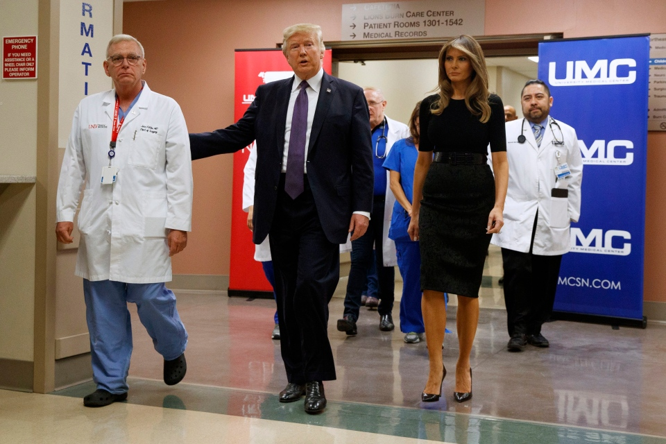 U.S. President Donald Trump and first lady Melania Trump walk through University Medical Center after meeting with victims of the mass shooting, Wednesday, Oct. 4, 2017, in Las Vegas. (AP Photo / Evan Vucci)