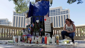 Allison Easterbrooks pauses at a memorial for the people killed in the 2017 Las Vegas mass shooting. (AP Photo/Marcio Jose Sanchez)