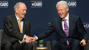 Former U.S. president Bill Clinton, right, and former Canadian prime minister Jean Chretien laugh during a discussion on their time in office during an event to mark Canada's 150th anniversary in Montreal, Wednesday, October 4, 2017. THE CANADIAN PRESS/Graham Hughes