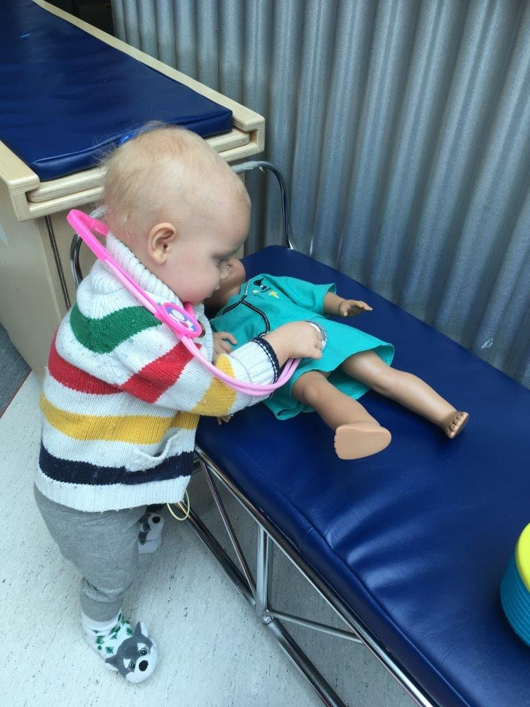 'Doctor' Aubrey examines a doll at BC Children's Hospital.