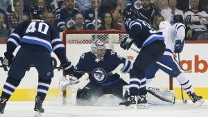 Toronto Maple Leafs' Patrick Marleau scores on Winnipeg Jets goaltender Steve Mason as Joel Armia and Dustin Byfuglien defend during second period NHL action in Winnipeg on Wednesday, Oct. 4, 2017. (John Woods / THE CANADIAN PRESS)