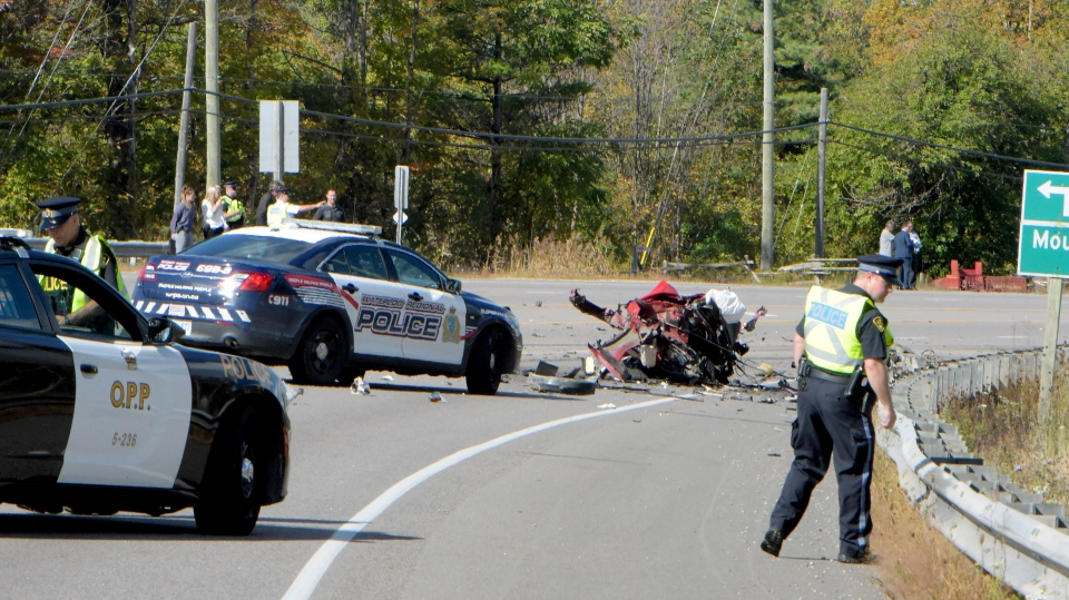 Police and firefighters are seen after a crash that killed a pair of teens in Freelton, Ont. on Oct. 5. (Andrew Collins)