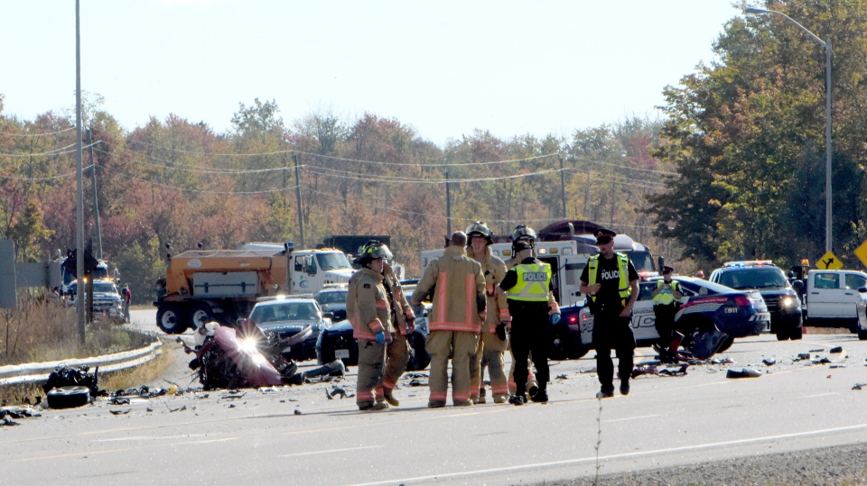 Police and firefighters are seen after a crash that killed two teens in Freelton, Ont. on Oct. 5. (Andrew Collins)