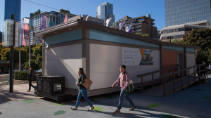 A temporary modular housing suite is visited by the public while on display in Robson Square in downtown Vancouver, B.C. on Tuesday October 3, 2017. (THE CANADIAN PRESS/Ben Nelms)