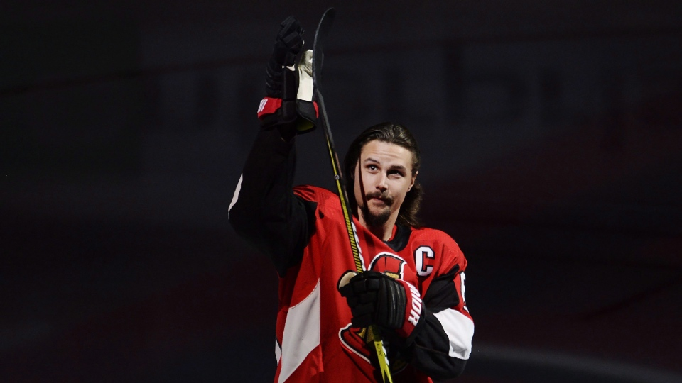 Injured Ottawa Senators defenceman Erik Karlsson (65) acknowledges the home crowd during player introductions prior to NHL hockey action against the Washington Capitals in Ottawa on Thursday, Oct.5, 2017. Karlsson is not in today's lineup. (Adrian Wyld/THE CANADIAN PRESS)