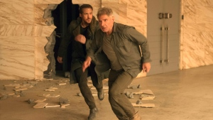 This image released by warner Bros. Pictures shows Ryan Gosling, left, and Harrison Ford in a scene from 'Blade Runner 2049.' (Stephen Vaughan/Warner Bros. Pictures via AP)