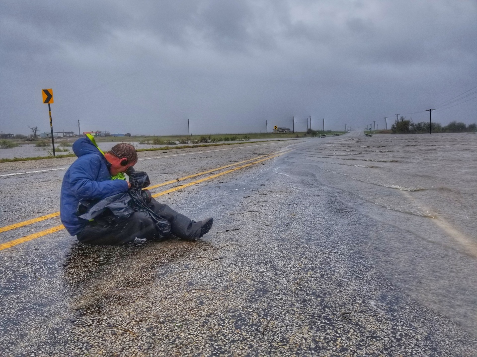 W5 Cameraman Jerry Vienneau filming water engulfing the highway to Rockport, Texas (Paul Haber / W5)