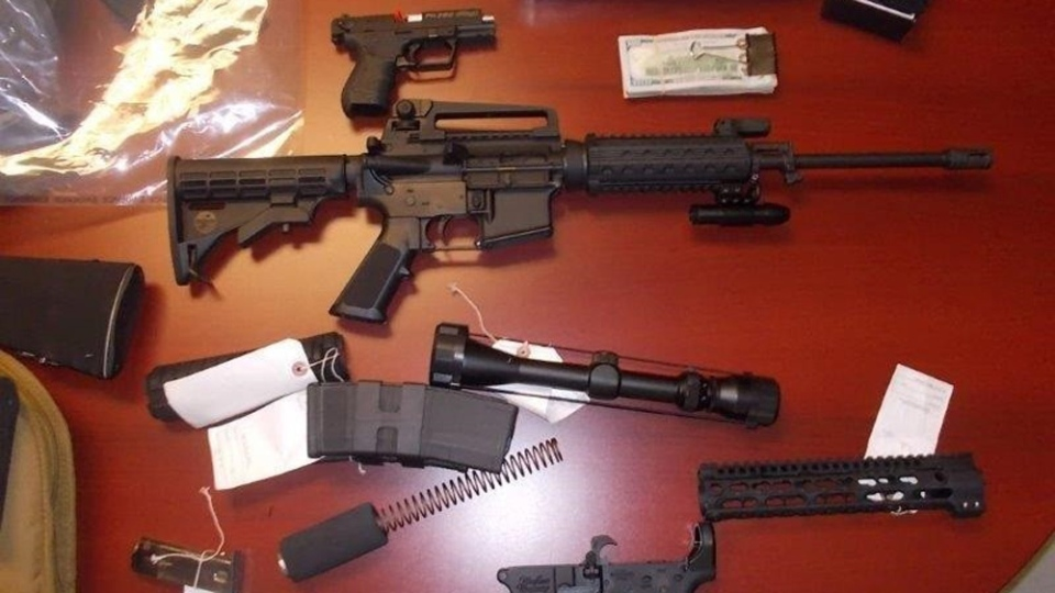 The RCMP searched a home in Teeds Mills, where they seized a number of firearms and ammunition, as well as a large quantity of cash, on Thursday. (New Brunswick RCMP)