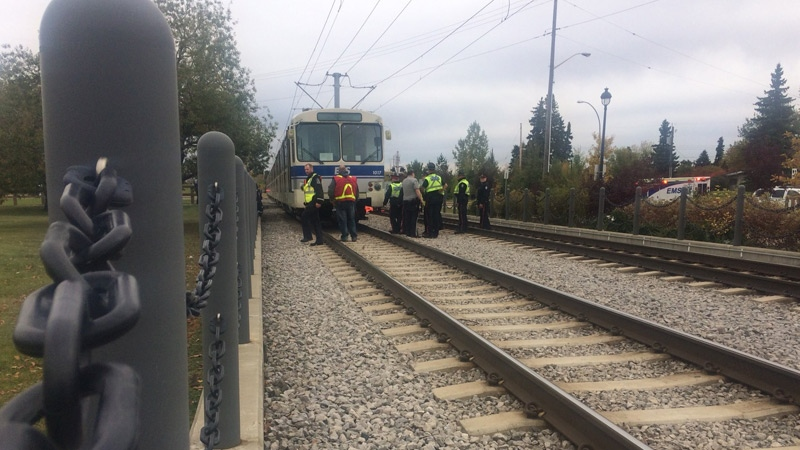 EPS and emergency crews on the scene, after a male pedestrian was struck and killed by a northbound LRT train, in the area of 113 St. and 60 Ave. Friday, October 6, 2017.