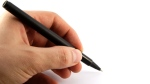 A person holding a pen is shown in this file photo. (©mpanch)