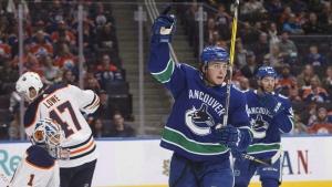 Vancouver Canucks' Jake Virtanen (18) celebrates a goal on Edmonton Oilers' goalie Laurent Brossoit (1) during first period pre-season NHL action in Edmonton, Alta., on Friday September 22, 2017. THE CANADIAN PRESS/Jason Franson