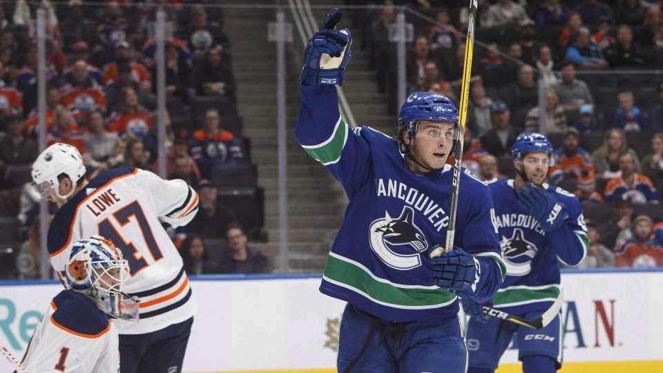 Vancouver Canucks' Jake Virtanen (18) celebrates a goal on Edmonton Oilers' goalie Laurent Brossoit (1) during first period pre-season NHL action in Edmonton, Alta., on Friday September 22, 2017. THE CANADIAN PRESS/Jason Franson