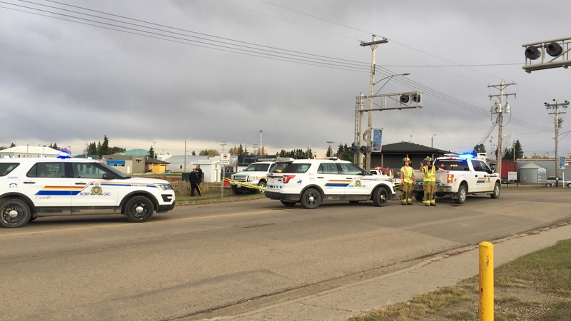 RCMP and emergency crews on the scene, after a gas station attendant was run over by a moving van in an apparent 'gas and dash' in Thorsby on Friday, October 6, 2017.