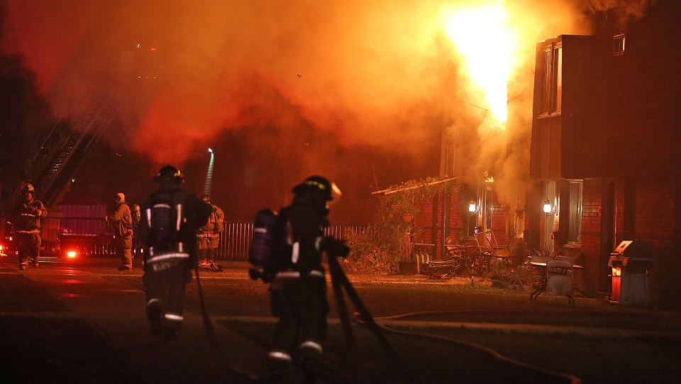 Firefighters are shown at the scene of a three-alarm blaze on Bloor Street near Dixie Road in Mississauga early Saturday morning. (John Hanley)