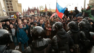 Riot police officers block protesters with Russian flags during a rally in Moscow, Russia, Saturday, Oct. 7, 2017. (Ivan Sekretarev/AP)