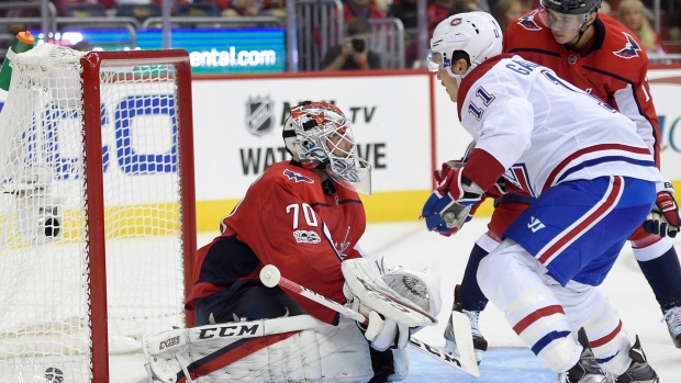 Montreal Canadiens right wing Brendan Gallagher (11) scores a goal against Washington Capitals goalie Braden Holtby (70) during the second period of a NHL hockey game, Saturday, Oct. 7, 2017, in Washington. (AP Photo/Nick Wass)