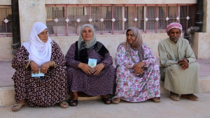 Kurdish citizens wait outside a polling station to elect new local councils of the three Kurdish-administered areas in northern Syria, known as Rojava, at a polling station, in Kobani, Syria on Sept. 22, 2017. (Rania Mohammed, Press Office of the Kurdish Self-administration Office in Kobani)