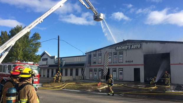 Calgary Fire Department members at the scene of Sunday morning's fire at Rachid's Auto in Foothills Industrial Park