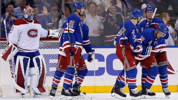 New York Rangers' Brady Skjei (76) is congratulated by teammates after scoring a goal past Montreal Canadiens goalie Carey Price in the first period of an NHL hockey game Sunday, Oct. 8, 2017, in New York. (AP Photo/Adam Hunger)