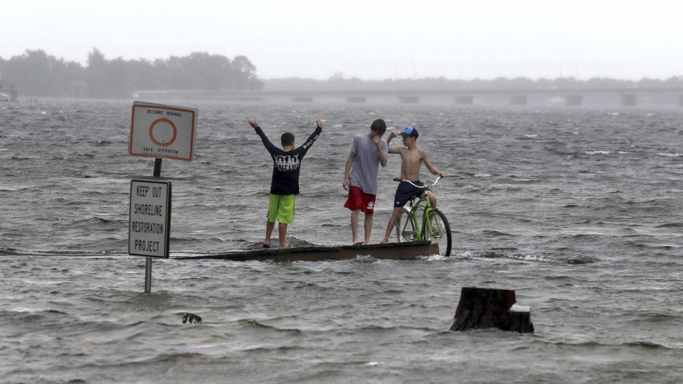 Nate marches across U.S. East Coast, dumping heavy rains