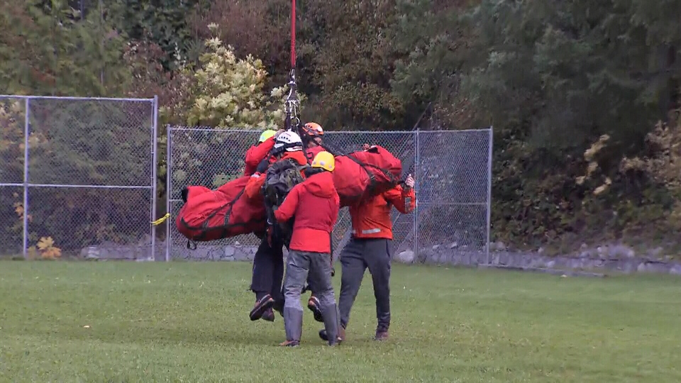 Rescuers airlift an injured trail runner who became stranded on Mount Harvey on Sunday, Oct. 8, 2017.