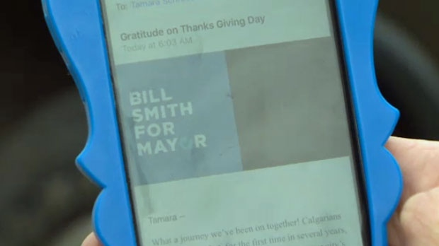 Tamara Schroeder displays the unsolicited email she received from the Bill Smith for Mayor campaign on Monday morning
