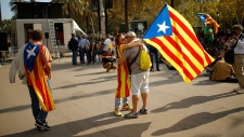 A woman holds a Catalan flag