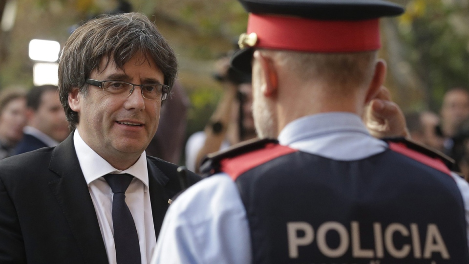 Catalan regional President Carles Puigdemont arrives at the parliament in Barcelona, Spain, on Oct. 10, 2017. (Manu Fernandez / AP )