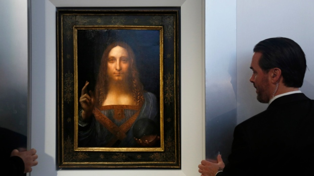 FILE - Security guards open a door to reveal 'Salvator Mundi' by Leonardo da Vinci during a news conference at Christie's in New York on Tuesday, Oct. 10, 2017. (AP / Seth Wenig)
