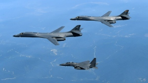 In this June 20, 2017 photo provided by South Korean Defense Ministry, U.S. Air Force B-1B bombers, top, and second from top, and South Korean fighter jets F-15K fly over the Korean Peninsula, South Korea. (South Korean Defense Ministry via AP, File)