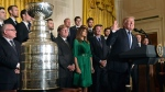 President Donald Trump, right, talks about the 2017 NHL Stanley Cup Champion Pittsburgh Penguins, Tuesday, Oct. 10, 2017, in the East Room of the White House in Washington. First lady Melania Trump, in green, and Penguinsowner Ronald Burkle, center, listen. (AP Photo/Susan Walsh)
